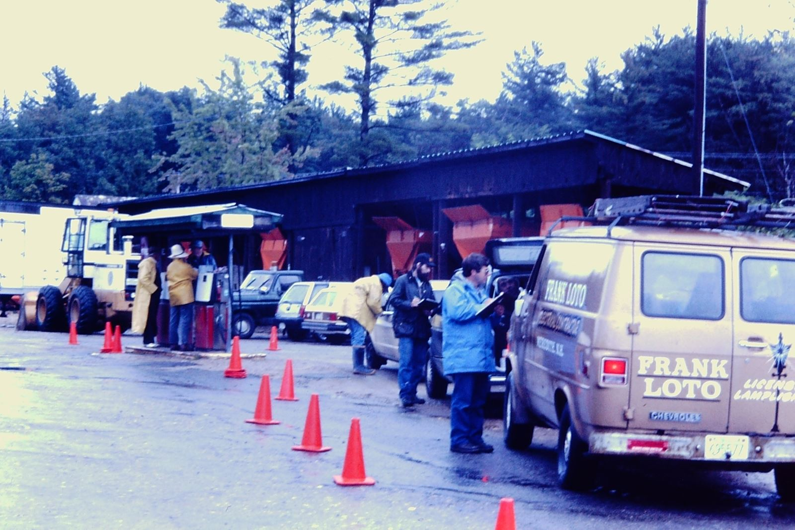 A line of vehicles being checked in for HHW collection